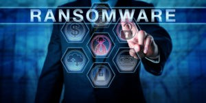 Male cybersecurity threat systems manager pushing RANSOMWARE