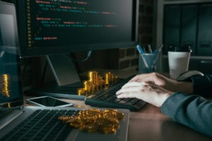 Hacker using computer internet virus and typing data steal information in order to request ransom bitcoin gold