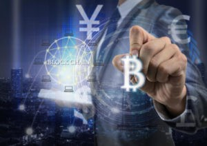 Double exposure of businessman using tablet and writing about Bitcoins and Block Chain