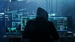 Hacker in front of a Computer