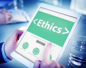 Tablet with ethics written on the desktop.