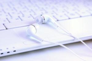 Headphones on laptop.