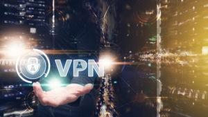 Man holding VPN ilustration.