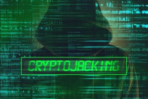Man in a hoody eith cryptojacking sign.