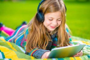 Kid listening to YouTube Kids.