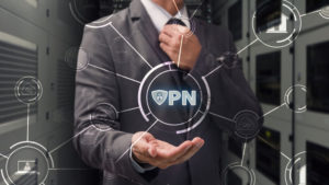 Man holding Virtual Private Network sign in his hand.