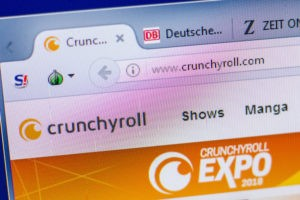 Homepage of Crunchyroll website on the display of PC, url - Crunchyroll.com. - Image