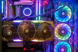 Close-up and inside Desktop PC Gaming and Cooling Fan CPU with multicolored LED RGB light show status on working mode, interior PC case technology background (1)