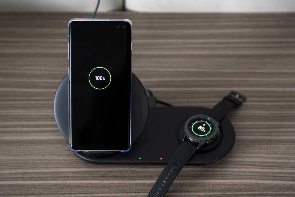 Galaxy watch and Samsung Galaxy S10 smartphone batteries charged