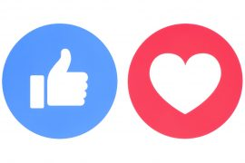 Facebook like and love icons of Empathetic Emoji Reactions, printed on paper.