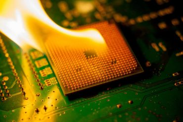 fire Burning cpu on circuit board with electronic (1)