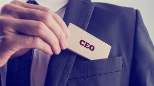 An image featuring a person wearing a suit and getting out his CEO card from his pocket representing a CEO concept