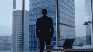 An image featuring a businessman standing representing a CEO concept