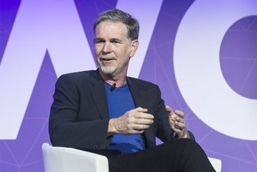 An image featuring a picture of Reed Hastings, the CEO of Netflix