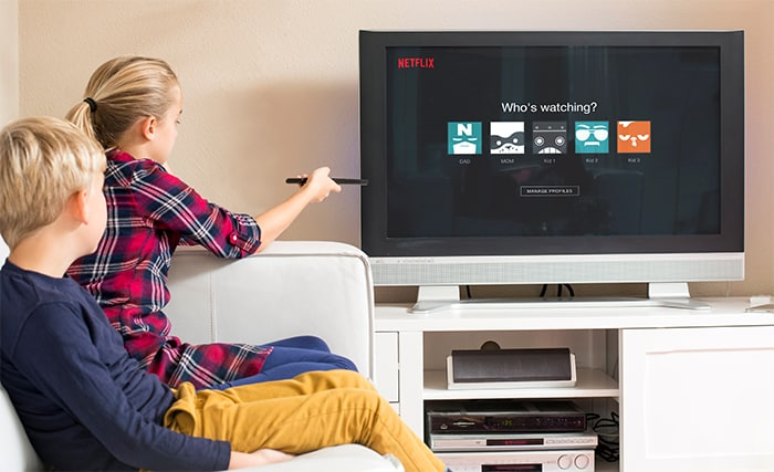 An image featuring two kids watching Netflix representing Netflix family shows and movies concept