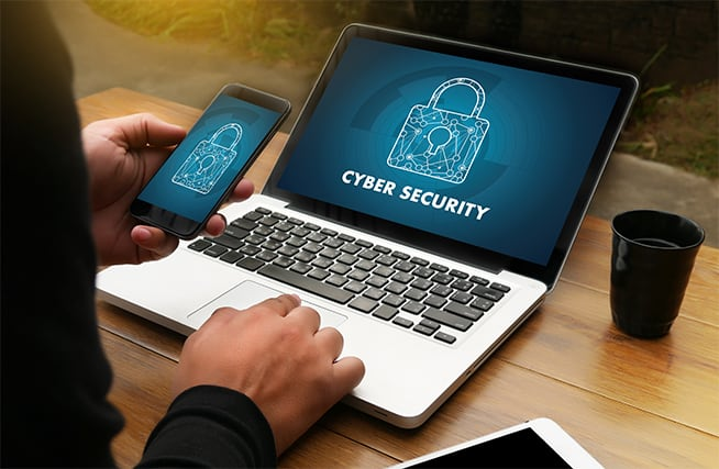 an image with cyber security on laptop background