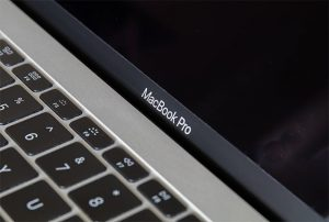 an image with MacBook Pro with black background