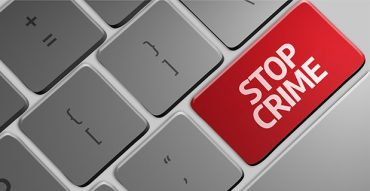 an image with Stop Crime red button on keyboard